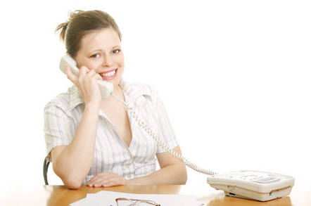 Woman smiling on phone/. photo by shutterstock