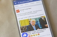 Trump facebook smartphone photo via Shutterstock