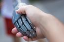 Robot hand human handshake photo via Shutterstock