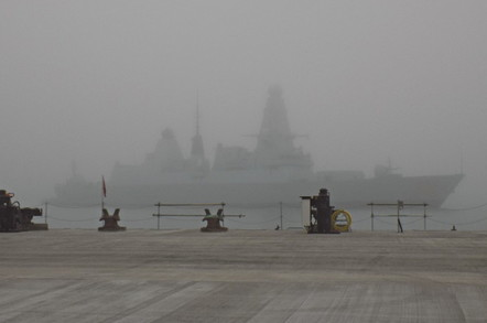 HMS Dragon emerging from the fog at HM Naval Base Portsmouth