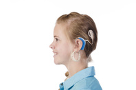 Young girl with a cochlear implant. Photo by shutterstock/Elsa Hoffmann