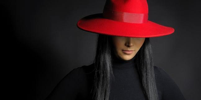 Woman in ret hat photo via Shutterstock