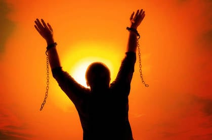 A person breaking free of shackles