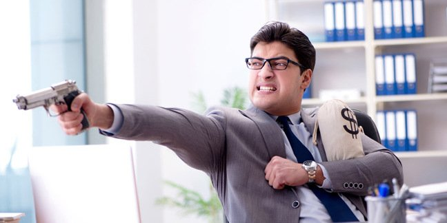Businessman with money bag and gun photo via Shutterstock