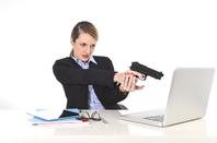 Woman and gun photo via Shutterstock
