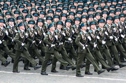 Soliders marching photo via Shutterstock
