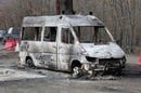 Burned out van photo via Shutterstock