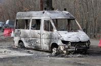 Burned out van photo via Shutterstock