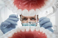 A dentist examining teeth