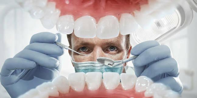 A dentist examining teeth