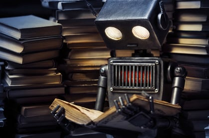 Young robot studying photo via Shutterstock