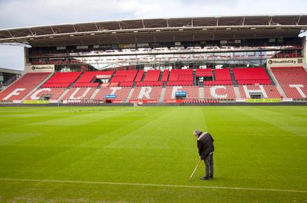 Football stadium photo via Shutterstock