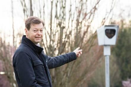 Mats Jarlstrom, pointing to a traffic light camera