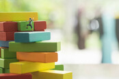 "Little climbers move up a ""stack"" of coloured blocks. Pic by SHutterstock"
