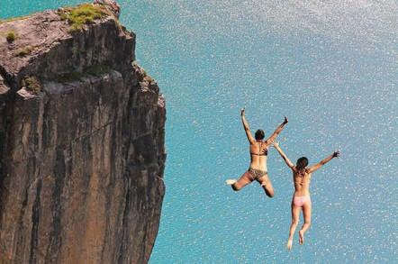 People diving off a cliff
