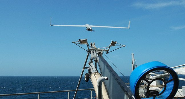 An Insitu Scaneagle drone being launch from a Royal Navy warship. Crown copyright