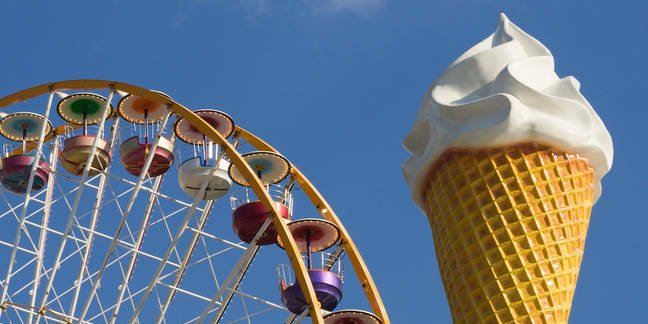 Giant ice cream cone in front of a ferris wheel at the Vincennes fair (Foire du Trone) - Paris, France Photo by  ErickN / Shutterstock.com