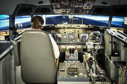 Aurora Flight Sciences' ALIAS robot in a simulated 737 cockpit