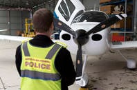 A plane seized in raids on the alleged owners of Plutus Payroll