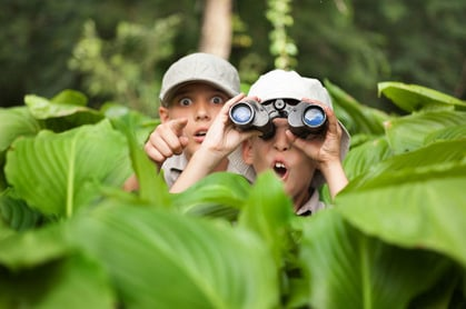 Boy with binoculars photo via Shutterstock