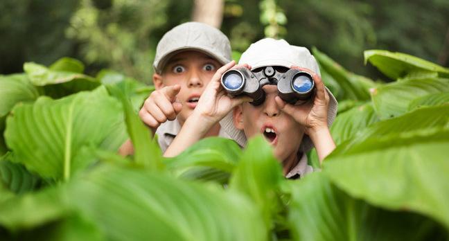 Boy with binoculars photo via Shutterstock
