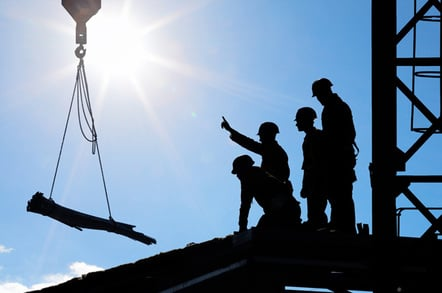 Construction workers photo via Shutterstock