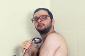 Nerd in shower photo via Shutterstock