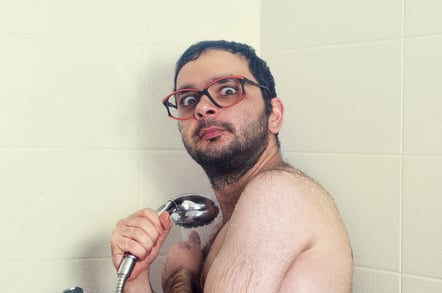 Nerd in shower photo via Shutterstock