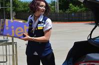 A Walmart worker delivering a package for the company