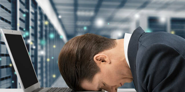 stressed exec in server room. pic shutterstock