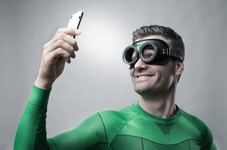Superhero on a mobile phone. pic by shutterstock