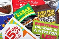 Junk mail piled up on a door mat. Pic via Shutterstock