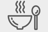 Steaming bowl of hot food with spoon