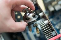 Tiny robot photo via Shutterstock