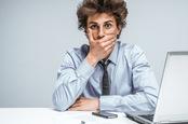 Surprised man computer photo via Shutterstock