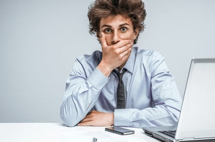 Surprised man computer photo via Shutterstock