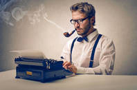 faux old-school reporter with suspenders, pipe and typewriter