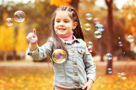 Girls with bubbles photo via Shutterstock