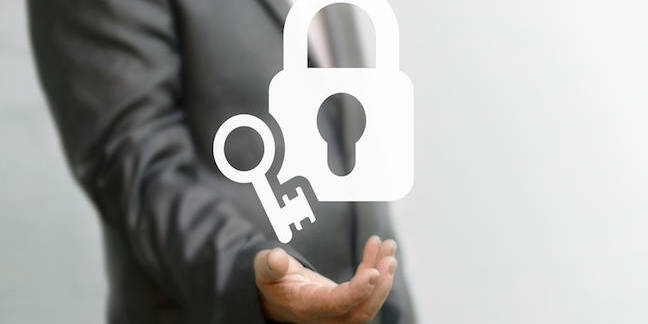 Businessman with unlocked padlock - shutterstck