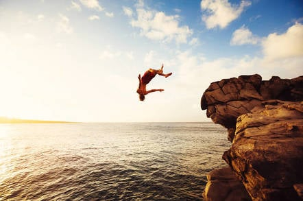 A man diving from a cliff