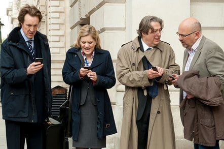Screengrab from the Thick of IT - Brit govt satirical comedy show. Cast text furiously while in crisis mode.