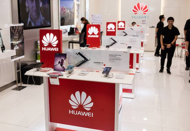 United States  lawmakers urge AT&T to cut all ties with Huawei