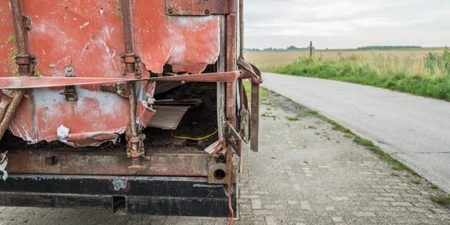 Broken container photo via Shutterstock