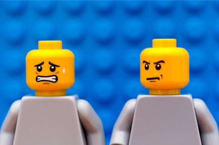 angry lego minifig man turns on anxious lego minifig man