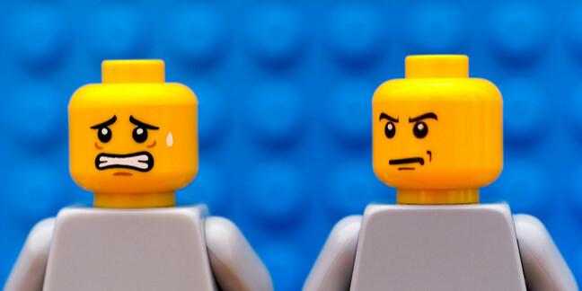 angry lego minifig man turns on anxious lego minifig man