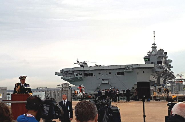 Admiral Sir Philip Jones, First Sea Lord, gives a speech in front of HMS Queen Elizabeth in Portsmouth. Pic: Gareth Corfield