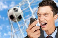 Man looking at phone misses goal being scored.