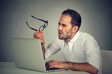 Man confused by laptop