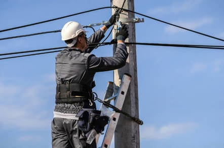 An engineer laying phone line