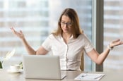 Woman annoyed at computer